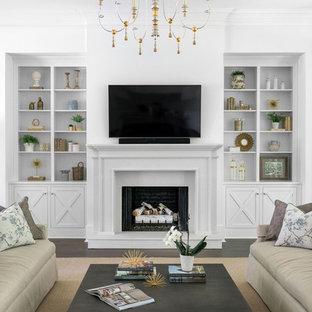アトランタの大きいトランジショナルスタイルのおしゃれなLDK (白い壁、濃色無垢フローリング、標準型暖炉、石材の暖炉まわり、壁掛け型テレビ、茶色い床) の写真