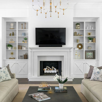 Inspiration for a large transitional open concept dark wood floor and brown floor living room remodel in Atlanta with white walls, a standard fireplace, a stone fireplace and a wall-mounted tv