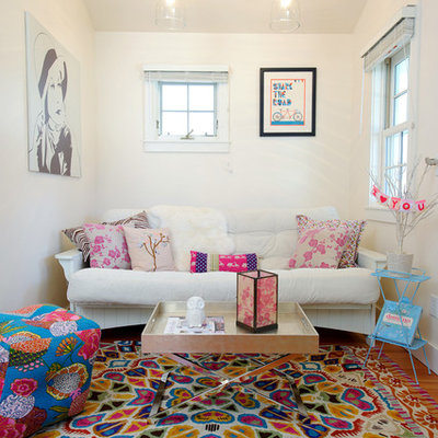 Living room - eclectic medium tone wood floor living room idea in Other with white walls
