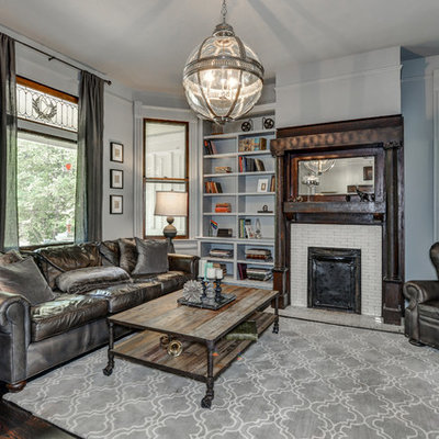 Example of a mid-sized classic enclosed dark wood floor living room library design in Atlanta with a standard fireplace, a tile fireplace and gray walls
