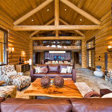 Rustic Living Room by Sticks and Stones Design Group Inc