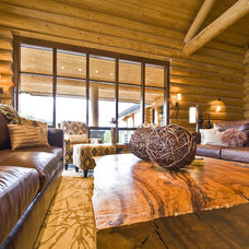 Rustic Living Room by Sticks and Stones Design Group inc.
