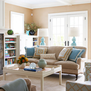Example of a coastal living room library design in New York with beige walls