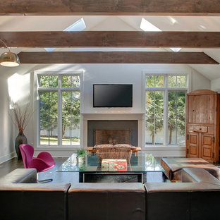 Large trendy open concept dark wood floor living room photo in Bridgeport with white walls, a standard fireplace, a wall-mounted tv and a concrete fireplace