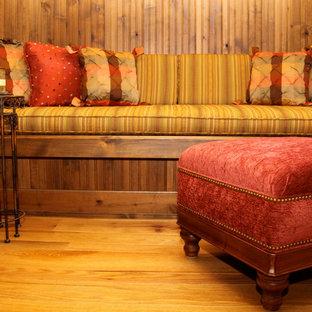 デンバーの小さいトラディショナルスタイルのおしゃれな独立型リビング (淡色無垢フローリング、茶色い壁、標準型暖炉、茶色い床、タイルの暖炉まわり) の写真
