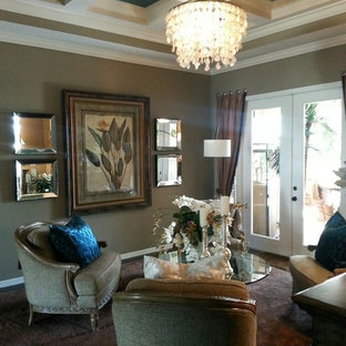 Inspiration for a large timeless formal and open concept porcelain tile living room remodel in Orlando with brown walls and no tv