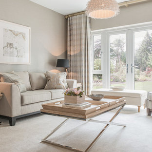 Photo of a medium sized modern formal enclosed living room in London with beige walls, carpet and a standard fireplace.