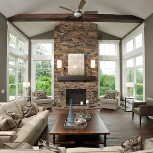 Example of a trendy living room design in Columbus with a stone fireplace