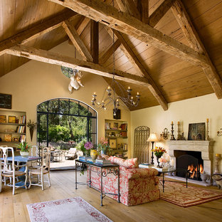 Tuscan living room photo in Santa Barbara with beige walls and a standard fireplace