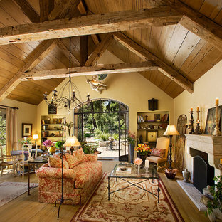 Inspiration for a huge mediterranean living room remodel in Santa Barbara with beige walls and a standard fireplace