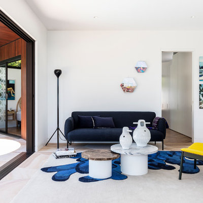 Living room - mid-century modern living room idea in Sydney with white walls and no fireplace