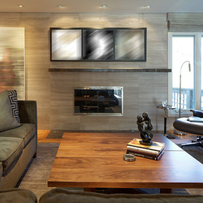 Living room - mid-sized contemporary enclosed carpeted and gray floor living room idea in Omaha with beige walls, a standard fireplace, a tile fireplace and no tv