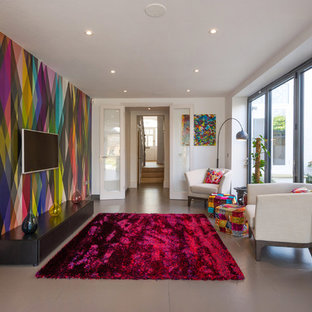 This is an example of a medium sized modern enclosed living room in London with a reading nook, multi-coloured walls, ceramic flooring and a wall mounted tv.