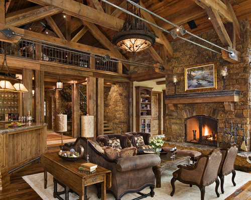 Example Of A Mountain Style Open Concept Living Room Design In Other With A  Standard Fireplace