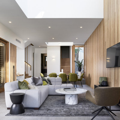 Minimalist open concept gray floor living room photo in Brisbane with white walls and a wall-mounted tv