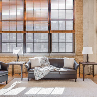 Urban Open Concept Light Wood Floor And Brown Living Room Photo In Milwaukee With No
