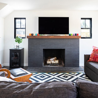 Inspiration for a mid-sized contemporary open concept dark wood floor and brown floor living room remodel in Seattle with white walls, a standard fireplace, a tile fireplace and a wall-mounted tv