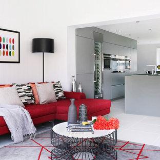 Inspiration for a huge contemporary porcelain floor living room remodel in London