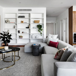 Photo of a contemporary open concept living room in Melbourne with white walls, dark hardwood floors and brown floor.