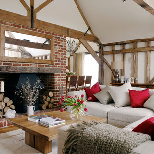 Inspiration for a cottage formal medium tone wood floor living room remodel in Other with white walls, a standard fireplace and a brick fireplace