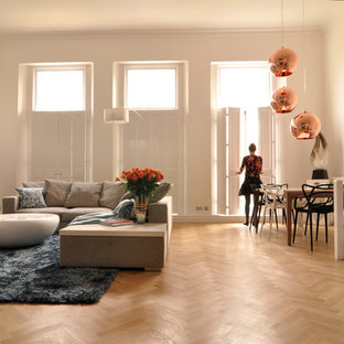 Trendy living room photo in London with white walls