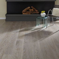 Optimistic Stone - Urban Collection - Create an atmosphere of uncompromising individuality with Optimistic Stone, from the Urban Collection, featuring prefinished oak flooring in a perfect grey tone with a natural mix of light and dark hues.