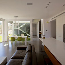 Modern Living Room by adom architects