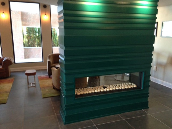 Modern Indoor Fireplaces by KJB FIREPLACES