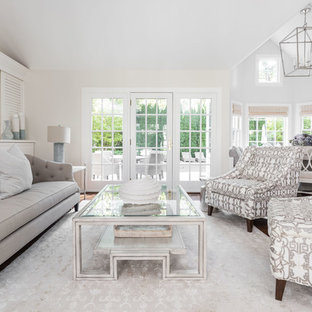 Inspiration for a beach style formal living room remodel in Boston with beige walls, a standard fireplace and no tv