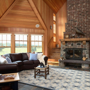 Photo of a country living room in Minneapolis with slate floors.