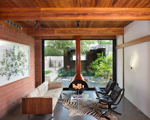 1960s Living Room Photo In Austin With White Walls, Concrete Floors, A  Hanging Fireplace