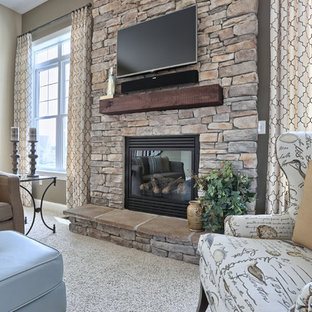 Large contemporary open plan living room in Philadelphia with brown walls, carpet, a standard fireplace, a stone fireplace surround, a wall mounted tv and beige floors.