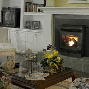 Mid-sized mountain style formal and enclosed dark wood floor living room photo in Denver with a wood stove, a metal fireplace, yellow walls and a tv stand
