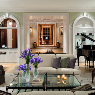 Inspiration for a timeless enclosed light wood floor living room remodel in Other with a music area, green walls and no tv