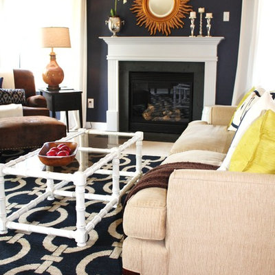 Transitional living room photo in Charlotte with blue walls and a standard fireplace