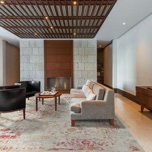 Ejemplo de salón con barra de bar abierto, contemporáneo, de tamaño medio, con paredes blancas, suelo de baldosas de porcelana, chimenea tradicional y marco de chimenea de madera
