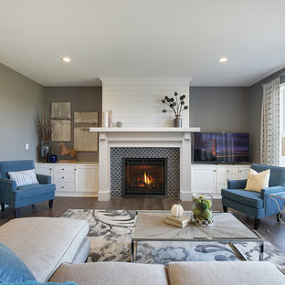 Inspiration for a mid-sized transitional formal and enclosed dark wood floor and brown floor living room remodel in Boston with gray walls, a standard fireplace, a tile fireplace and no tv
