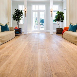 Living room - large traditional formal and open concept light wood floor living room idea in New York with beige walls