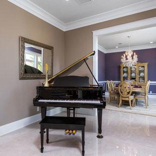 Foto de salón con rincón musical cerrado, clásico, de tamaño medio, sin chimenea y televisor, con paredes marrones, suelo de baldosas de porcelana y suelo beige
