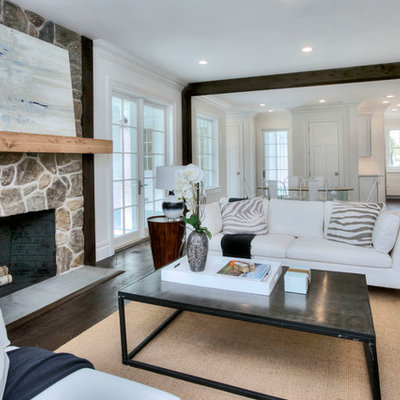 Inspiration for a large transitional formal and open concept dark wood floor and brown floor living room remodel in New York with white walls, a standard fireplace, a stone fireplace and no tv