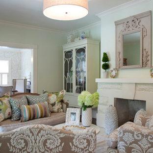 Idee per un grande soggiorno stile shabby chiuso con sala formale, pareti verdi, pavimento in legno massello medio, camino classico, nessuna TV, cornice del camino in pietra e pavimento bianco