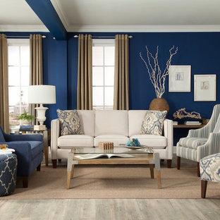 Idee per un soggiorno con pareti blu e parquet chiaro
