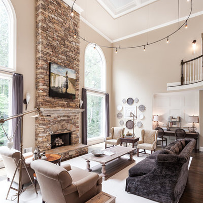 Large transitional formal and open concept dark wood floor and brown floor living room photo in Atlanta with beige walls, a standard fireplace, a stone fireplace and no tv
