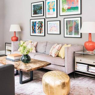 Foto de salón abierto, clásico renovado, de tamaño medio, con paredes grises, suelo de madera en tonos medios, chimenea tradicional, marco de chimenea de piedra, televisor colgado en la pared y suelo marrón