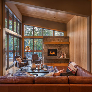 Mountain Style Medium Tone Wood Floor And Brown Floor Living Room Photo  With Brown Walls,