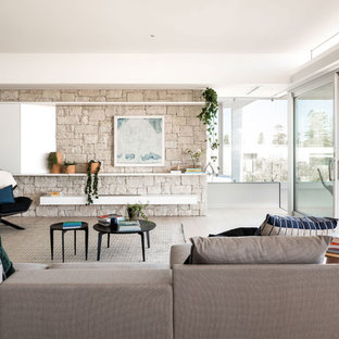 Modern living room in Perth with white walls, light hardwood floors and beige floor.