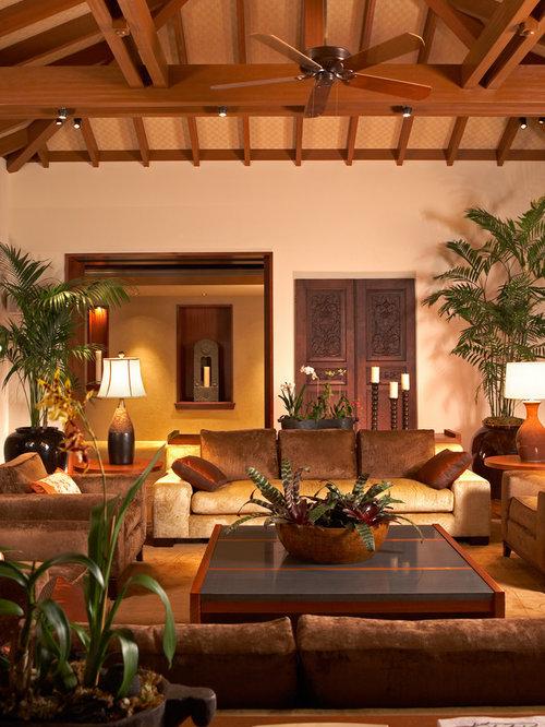 Huge island style living room photo in Hawaii with beige walls