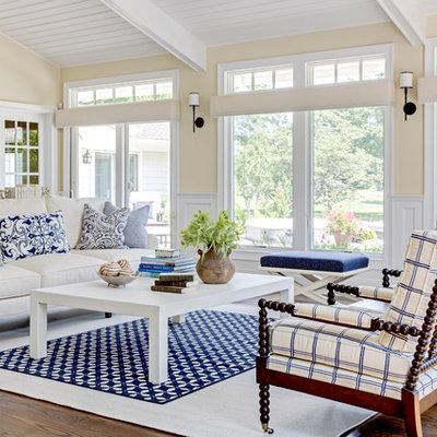 Inspiration for a large coastal open concept dark wood floor living room remodel in New York with beige walls