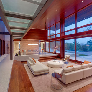 Example of a large minimalist open concept medium tone wood floor living room design in San Francisco with no tv
