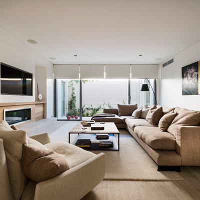 Large trendy open concept light wood floor living room photo in Perth with white walls, a ribbon fireplace and a media wall